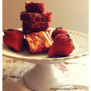 Red Velvet Cheesecake Brownies on White Pedastal Plate