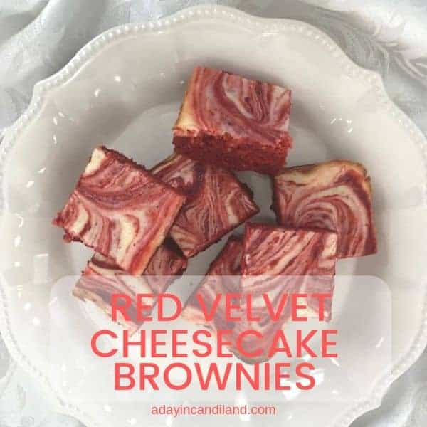 Red Velvet cheesecake brownies on white plate square image