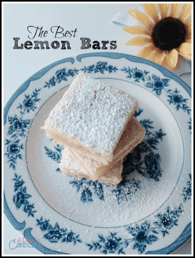The Best Lemon Bars ever on blue and white plate