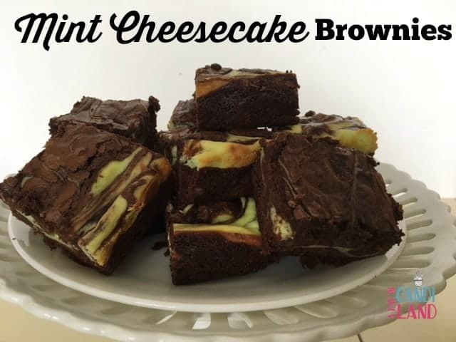 Mint Cheesecake Brownies on white pedestal plate