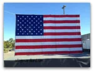 Large flags at the healing fields in Cathedral City