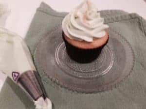 Key Lime Cupcake on plate with frosting tube