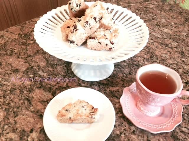 Starbucks Copycat Cranberry Orange Scones recipe next to cup of tea
