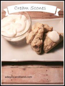 Cream scones and clotted cream on plate