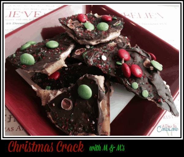 Christmas Crack with M & Ms on a Red Plate so delicious and addicting