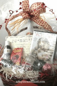 Create a Romantic Date Night Basket shrinkwrapped with movie, cider, massage oil, candles and chocolate