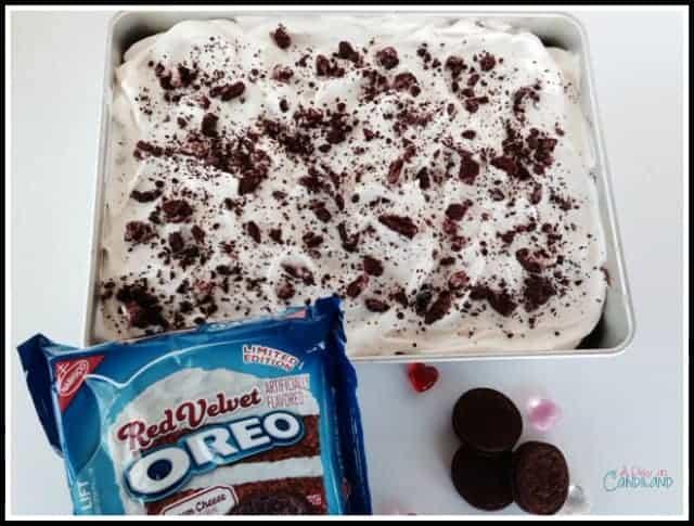 Red Velvet Oreo Poke Cake with cookies