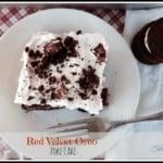 Slice of Red Velvet Oreo Poke Cake with Oreos