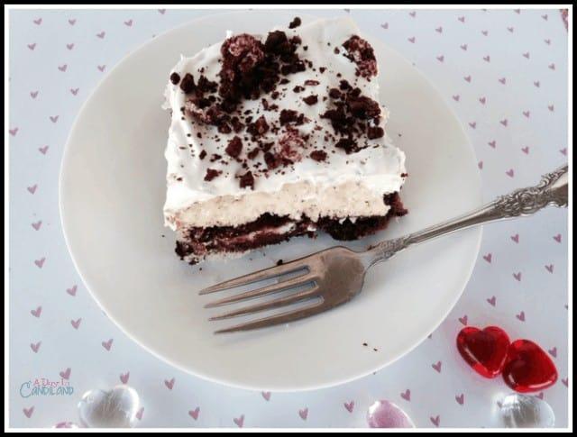 Slice of Red Velvet Oreo Poke Cake