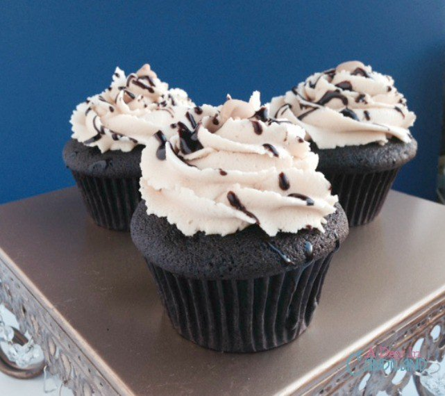 Dark Chocolate cupcakes with peanut butter frosting from (adayilncandiland.com)