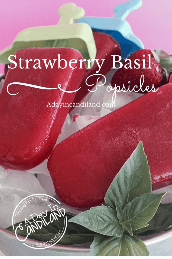 Strawberry Basil Popsicles on ice with fresh basil a great summer treat