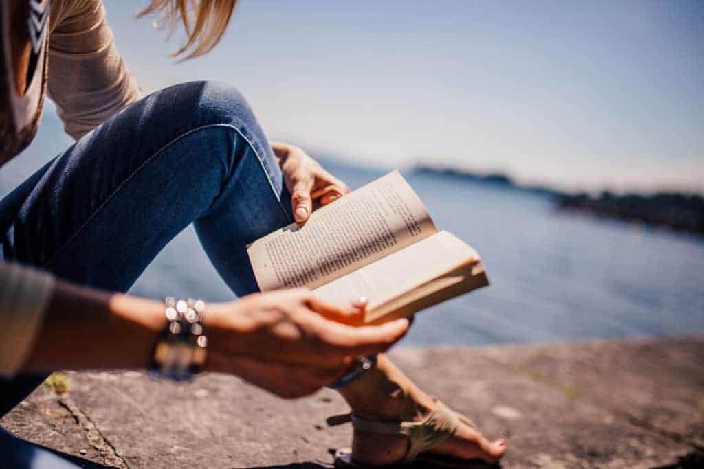 Reading Bible at the lake