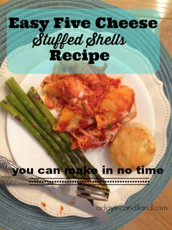 Easy Stuffed Shells Recipe on a plate with asparagus and dinner roll