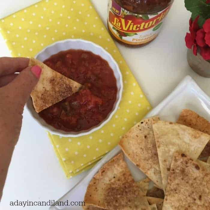 Cinnamon chips dipping into salsa