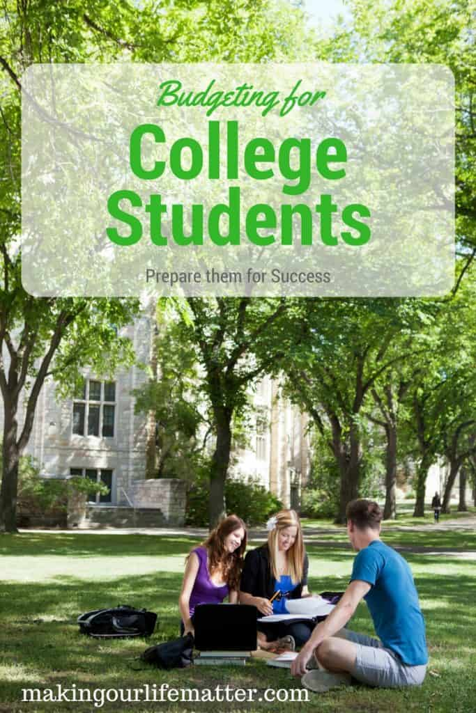 College students on a budget. Preparing for success. Students sitting on the lawn in front of the college.