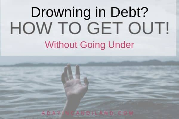 Drowning in debt with hand coming out of the ocean