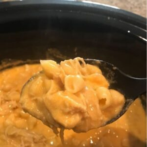 Spoon of Buffalo Mac and Cheese in crockpot