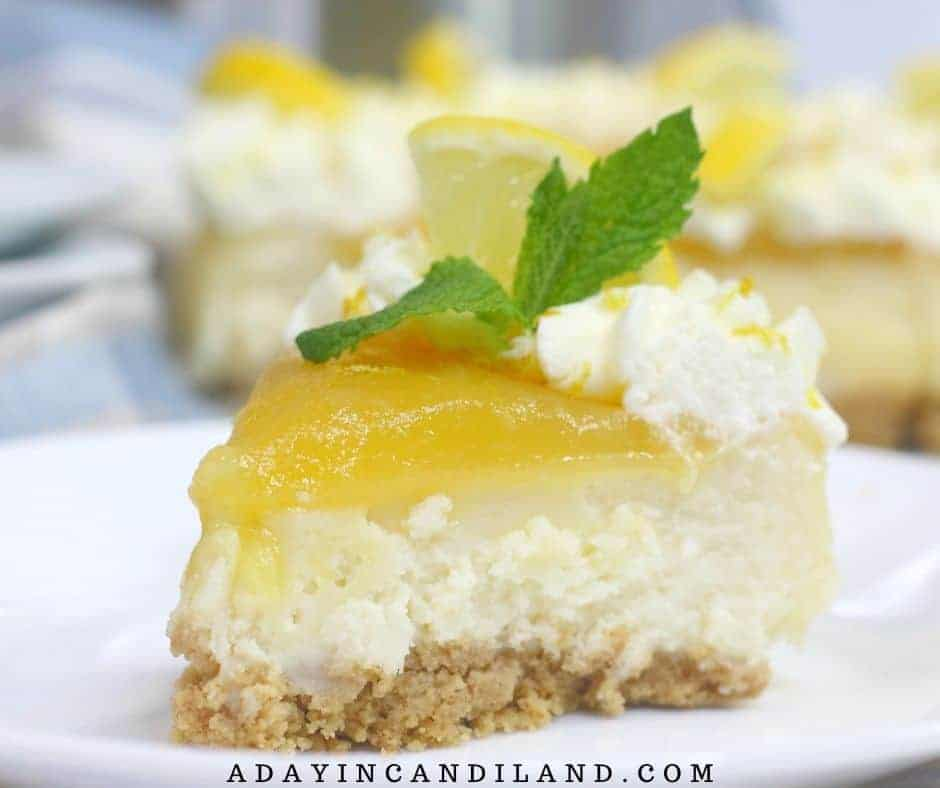 Slice of Lemon Curd Cheesecake with sprig of mint.