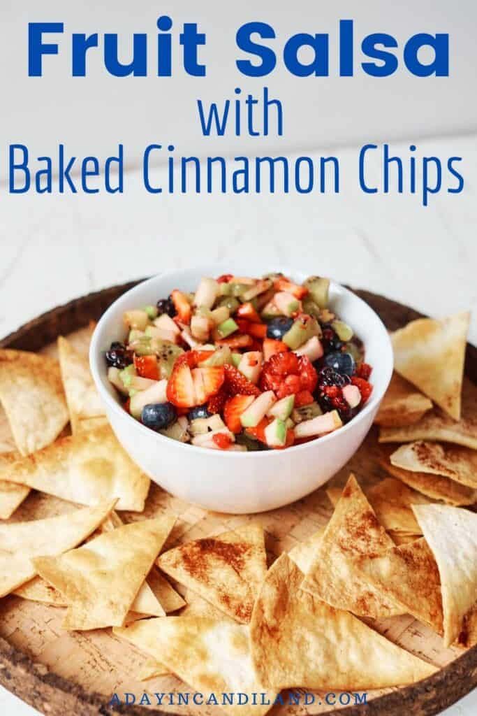White Bowl with Fruit Salsa and Cinnamon tortilla Chips around it.