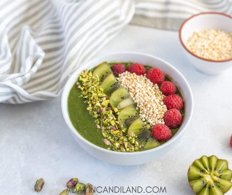 Green Smoothie bowl on table with napkin and a few ingredients