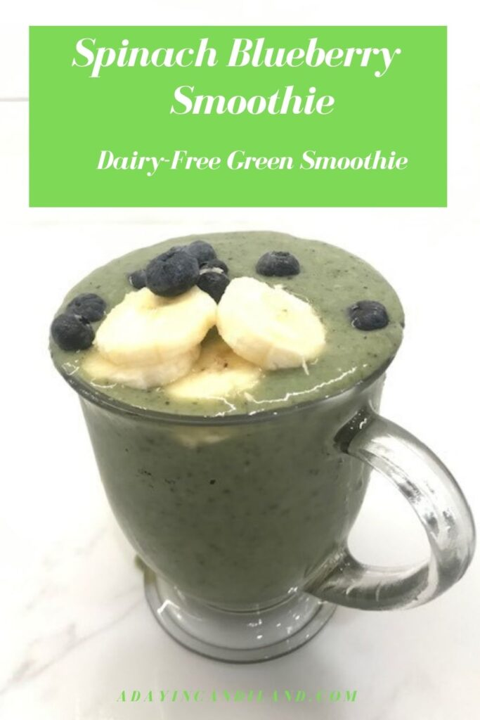 Glass of Green Smoothie with bananas and blueberries