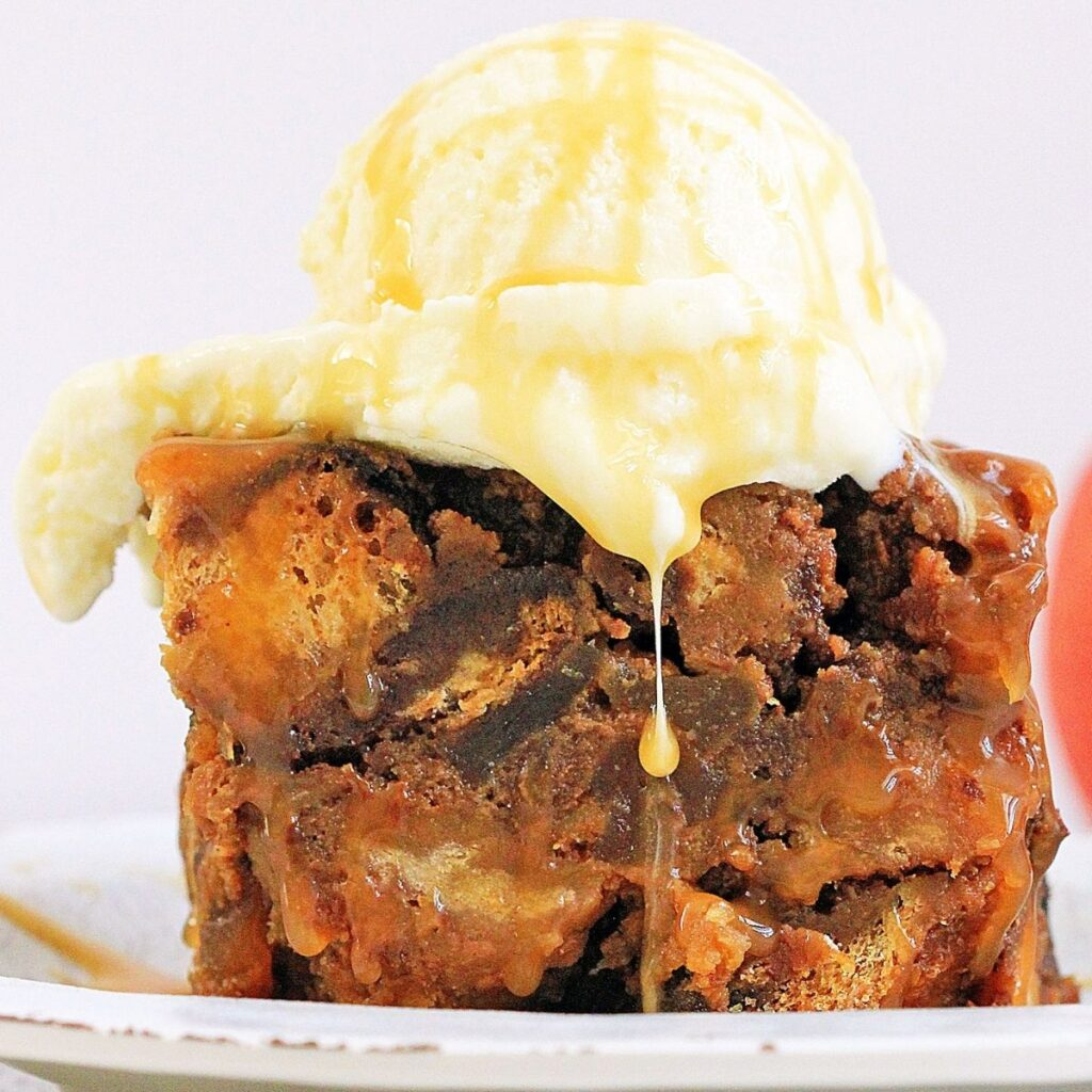 Slice of Bread Pudding with a scoop of ice cream on top