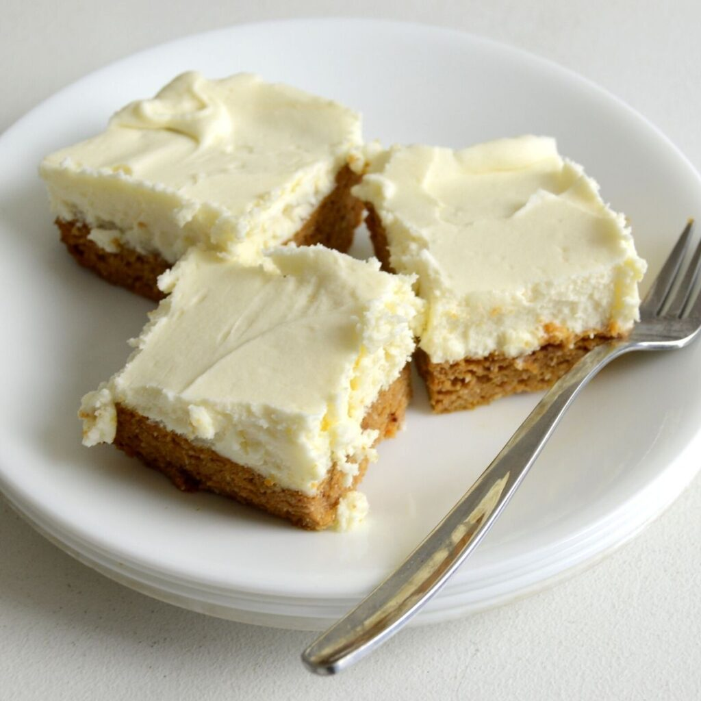 3 Slices of pumpkin bars on a plate with fork